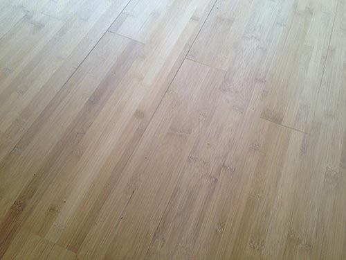 a bamboo floor after sanding with a rough grit