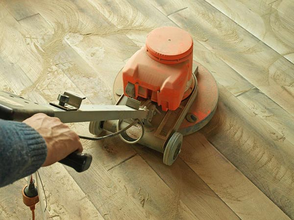 refinish hardwood floors with an orbital sander
